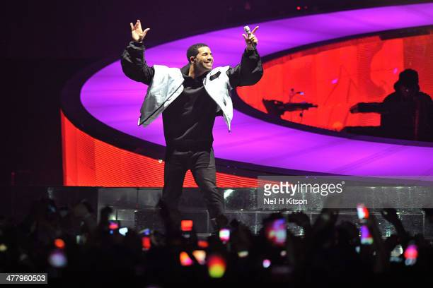 Drake performs on stage at Manchester Arena on March 11 2014 in Manchester United Kingdom
