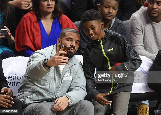 Drake takes a selfie witha fan at a basketball game between the Oklahoma City Thunder and the Los Angeles Clippers at Staples Center on December 21...