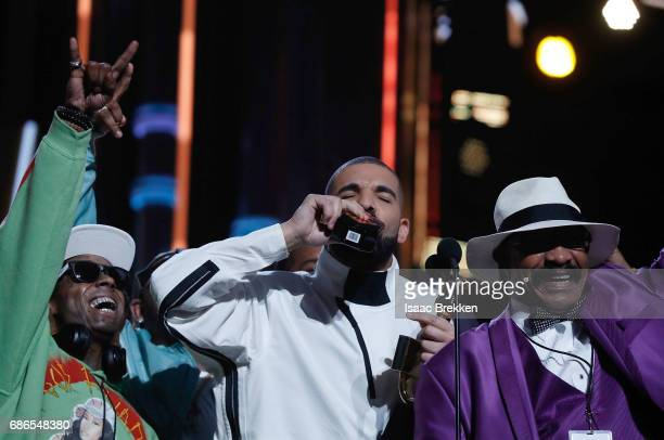 Drake takes a shot of Virginia Black Whiskey to celebrate winning the Billboard Artist of the Year Award at TMobile Arena on May 21 2017 in Las Vegas...