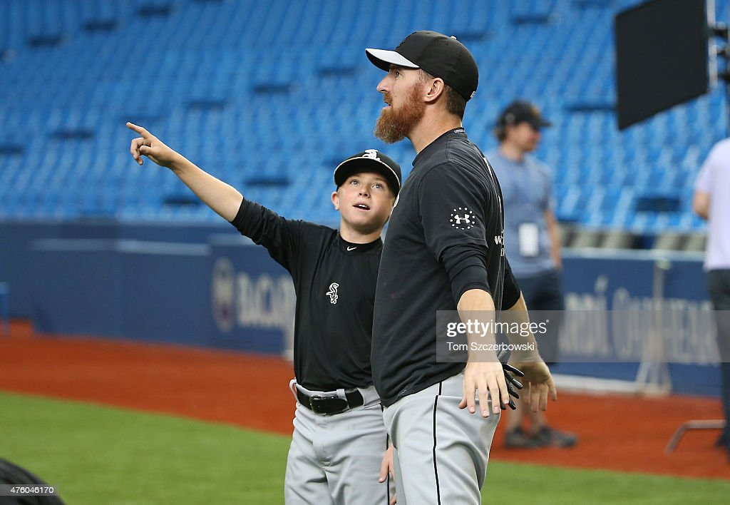 Drake the son of <a gi-track='captionPersonalityLinkClicked' href=/galleries/search?phrase=Adam+LaRoche&family=editorial&specificpeople=216533 ng-click='$event.stopPropagation()'>Adam LaRoche</a> #25 of the Chicago White Sox points to the roof as it opens during batting practice before the start of MLB game action against the Toronto Blue Jays on May 25, 2015 at Rogers Centre in Toronto, Ontario, Canada.