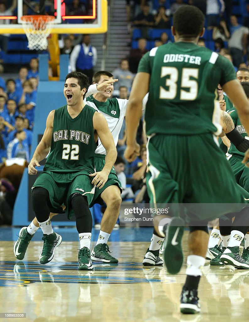 Drake U'u #22 of the Cal Poly Mustangs celebrates with teammates after the game against the UCLA Bruins at Pauley Pavilion on November 25, 2012 in Los Angeles, California. Cal Poly won 70-68.
