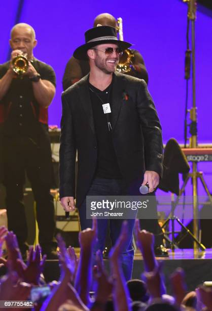 Drake White performs onstage during CMT Crossroads Earth Wind Fire and Friends on June 6 2017 in Nashville Tennessee