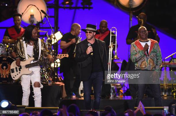 Drake White performs onstage with Verdine White and Philip Bailey of Earth Wind Fire during CMT Crossroads Earth Wind Fire and Friends on June 6 2017...