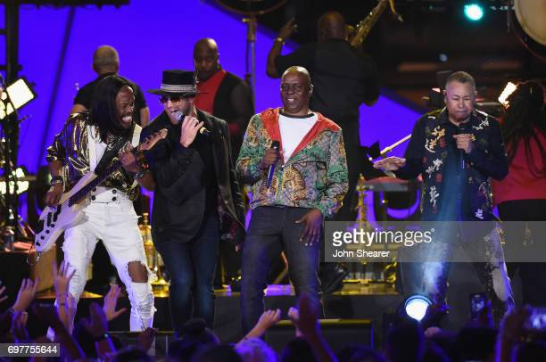 Drake White performs onstage with Verdine White Philip Bailey and Ralph Johnson of Earth Wind Fire during CMT Crossroads Earth Wind Fire and Friends...