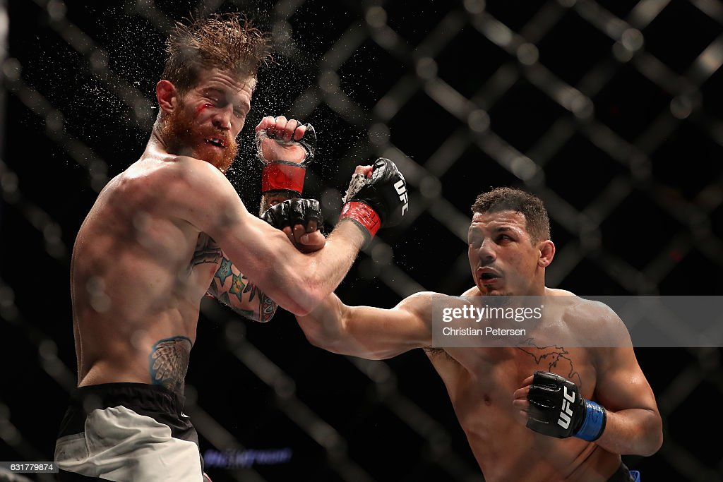 Drakkar Klose (R) lands a right on Devin Powell during the UFC Fight Night event at the at Talking Stick Resort Arena on January 15, 2017 in Phoenix, Arizona.