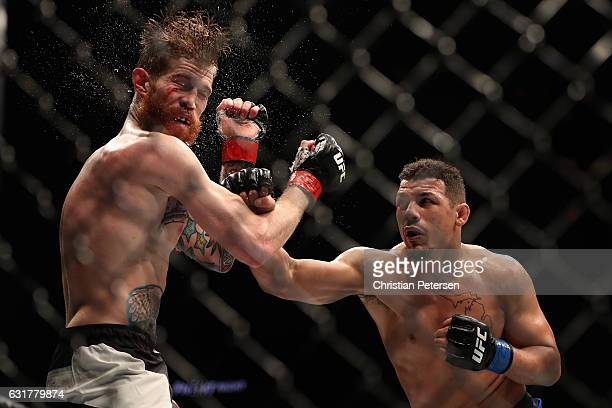 Drakkar Klose lands a right on Devin Powell during the UFC Fight Night event at the at Talking Stick Resort Arena on January 15 2017 in Phoenix...