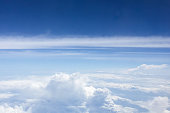 Dramatic atmosphere panorama aerial view of beautiful blue sky and clouds from the window of aircraft.