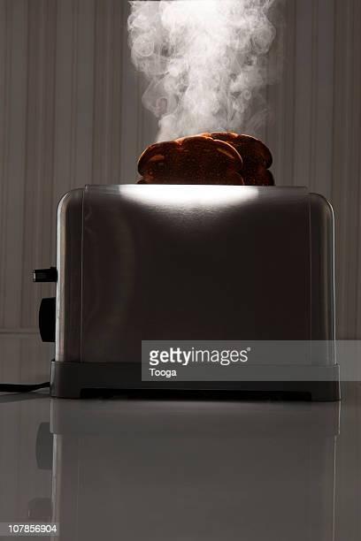 Dramatic burning toast in toaster