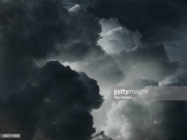 A dramatic cloudscape of black and white clouds
