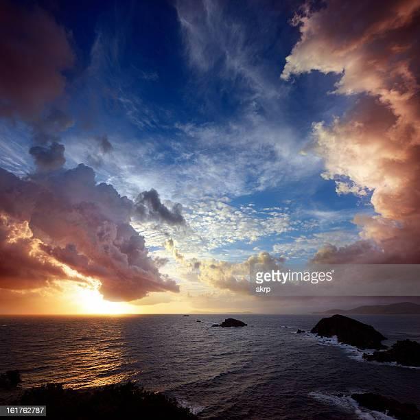 Dramatic Cloudscape over Rocky Coastline at the Cote D'Azur