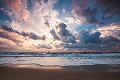 Dramatic cloudscape over the sea, sunrise shot