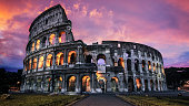 The Roman Colosseum stands guard against the fading day in the heart of ancient Rome, Italy.