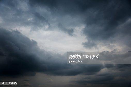 Dramatic dark sky and black clouds : Stock Photo