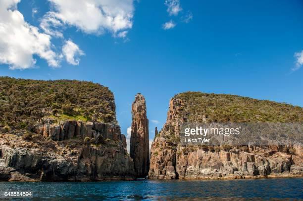 PENINSULA TASMANIA AUSTRALIA Dramatic dolerite columns known as The Totem Pole and Candlestick on the Tasman Peninsula in Tasmania Home to the penal...