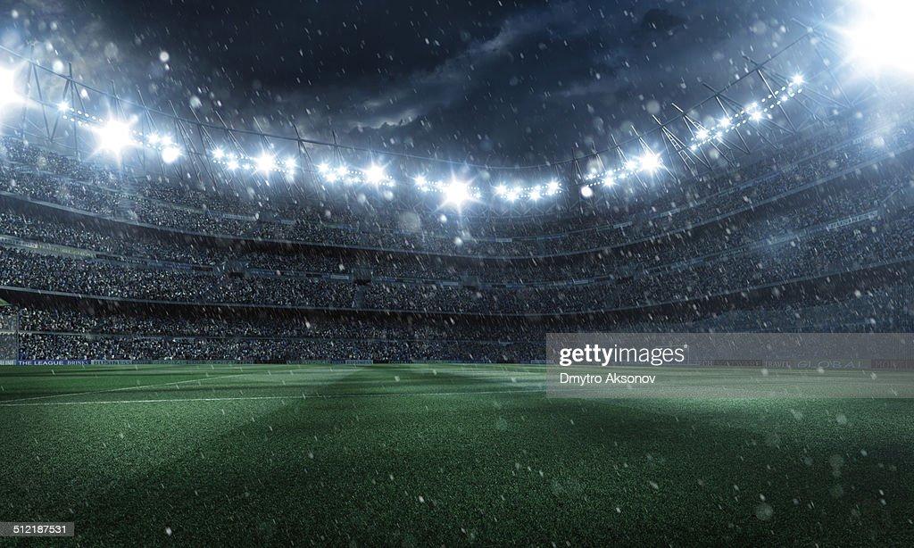 Dramatic football stadium with rain