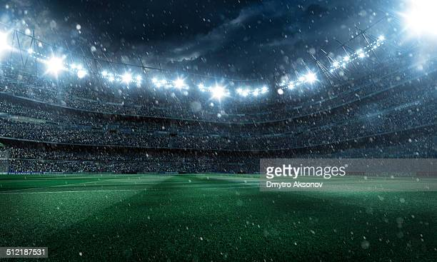 Dramatic football stadium with rain