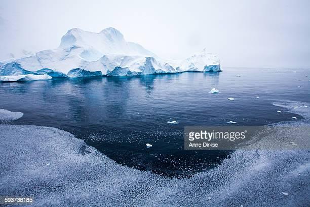 Dramatic iceberg with brash ice