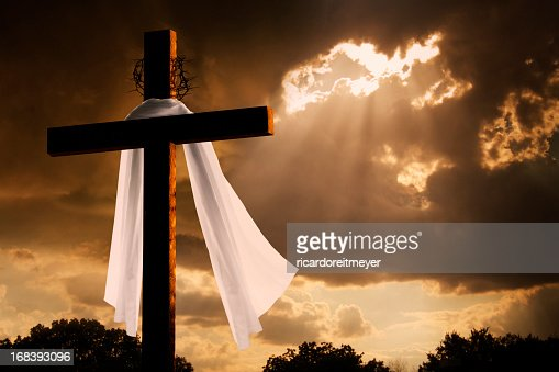 Dramatic Lighting on Christian Easter Cross As Storm Clouds Break