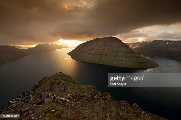 Dramatic mood lighting over the islands of Kalsoy, Kunoy and Bordoy, Borooy, Norooyar, Faroe Islands, Denmark