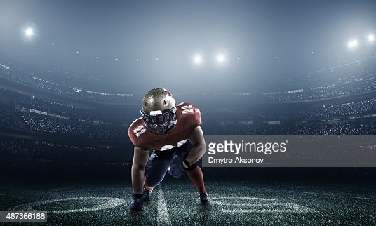 Dramatic picture of football player in stadium at night