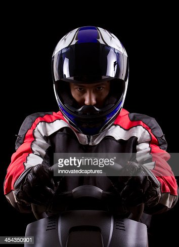 Dramatic portrait of a race car driver : Stock Photo