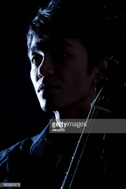 Dramatic portrait of a young man with guitar