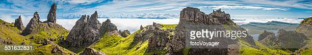 Dramatic rocky pinnacles panorama Storr Skye overlooking clouds Highland Scotland