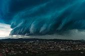 panoramic shot of dramatic storm cloud over city, Slovenia
