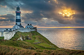 Stunning sunset scene at the lighthouse at The Old Head Of Kinsale