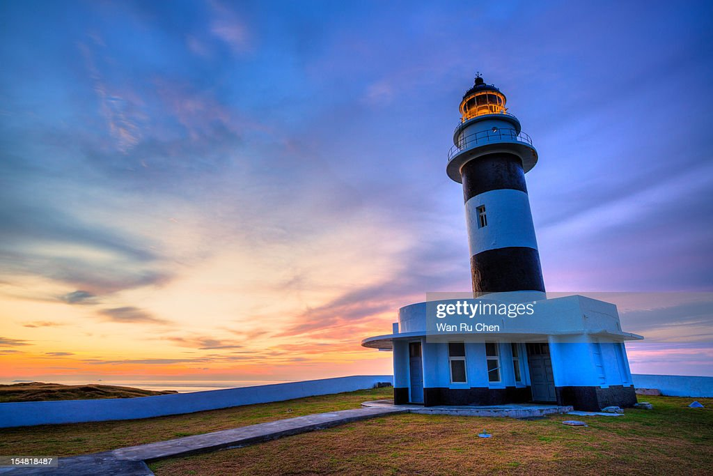 dramatic sky and lighthouse at sunset