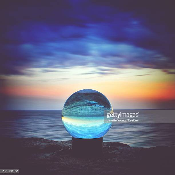 Dramatic sky and sea through crystal ball