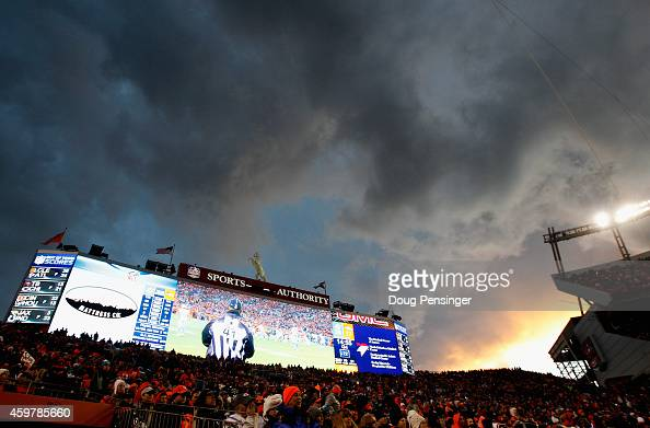 A dramatic sky hovers of the stadium as the Miami Dolphins face the Denver Broncos at Sports Authority Field at Mile High on November 23 2014 in...