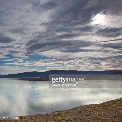 Dramatic sky over fjord : Stock Photo