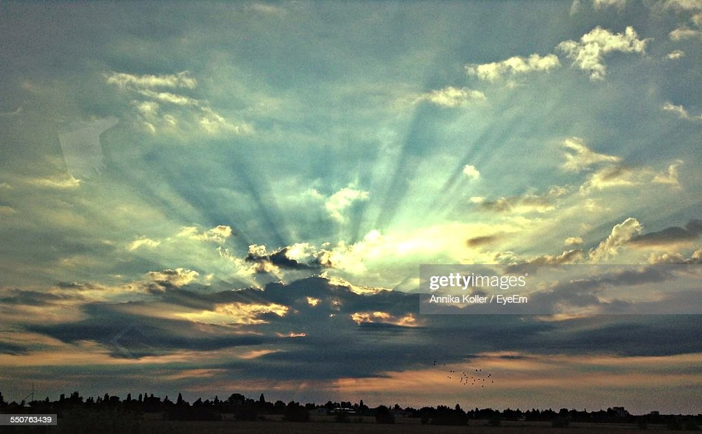 Dramatic Sky Over Landscape During Sunset