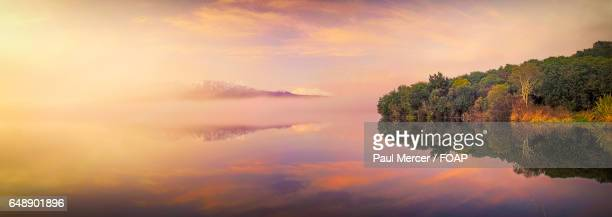 Dramatic sky reflecting on lake