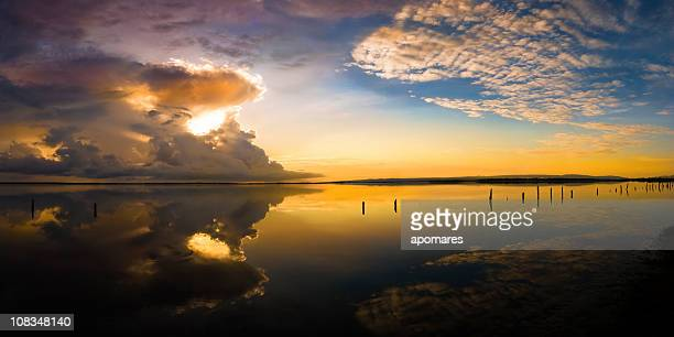 Dramatic sky reflection on a Tropical coastal lagoon at sunrise