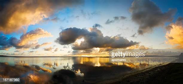 Dramatic sky reflection on coastal Caribbean lagoon at sunrise