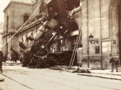 A dramatic snapshot photograph of a derailed steam locomotive at Montparnasse Station Paris taken by an unknown photographer The train from Granville...