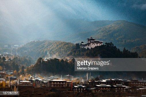 Dramatic sunrays over Jakar Dzong