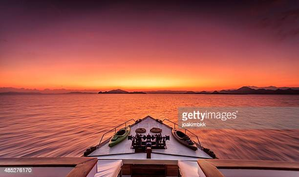 Dramatic sunrise at sea on a luxury yacht