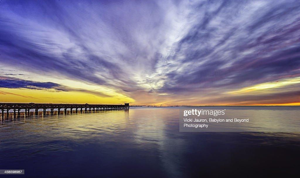 Dramatic sunrise over the fishing pier