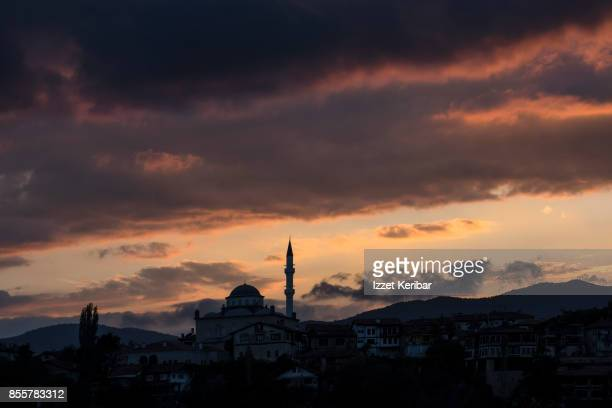 Dramatic sunset and silhouette of a small mosque at Safranbolu, Karabuk, Turkey