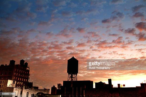Dramatic sunset on the roofs of New York City