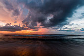 Deep colours shine in the sky as the sun sets over Lombok