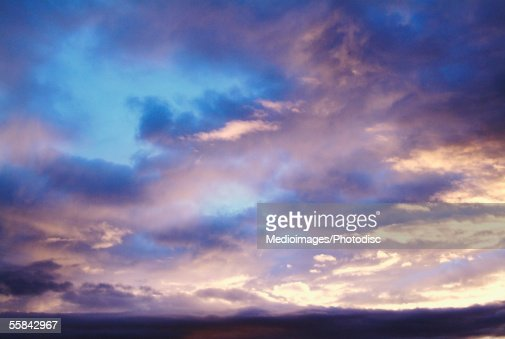 Dramatic sunset under cloudy skies : Stock Photo