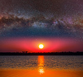 dramatic twilight scene, starry sky above the evening lake