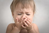 dramatically with creaming crying baby portrait very emotional