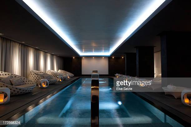 Dramatically lit swimming pool in health club