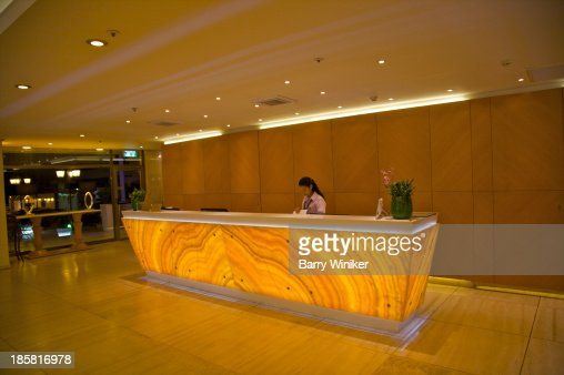 Dramaticy Stone Backlit Hotel Reception Desk Stock Photo