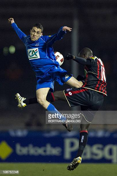 Drancy's midfielder Aziz Dahchour vies with Nice's forward Abdou Traore during the French Cup football match Drancy versus Nice at the Marville...
